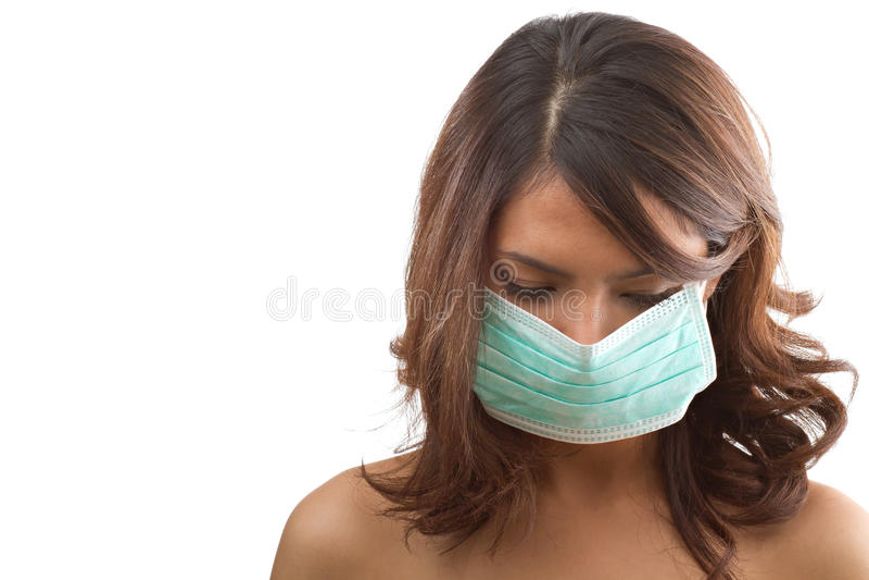Donna con la mascherina medica di influenza fotografia stock libera da diritti