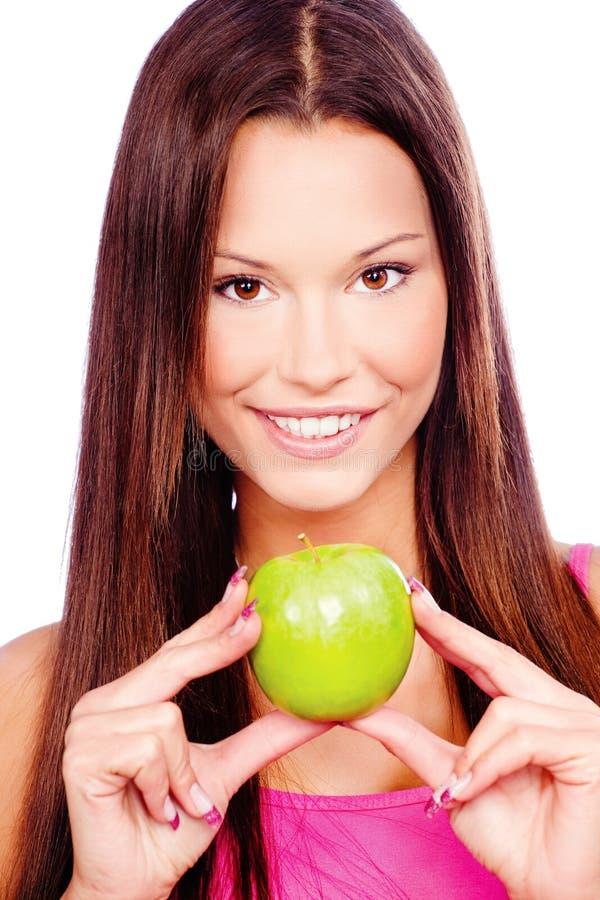 Donna con la mela verde fotografia stock libera da diritti