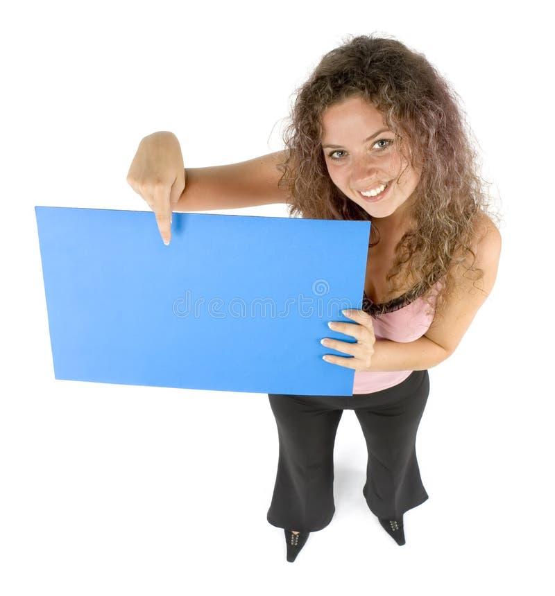 Donna con la scheda di messaggio fotografia stock