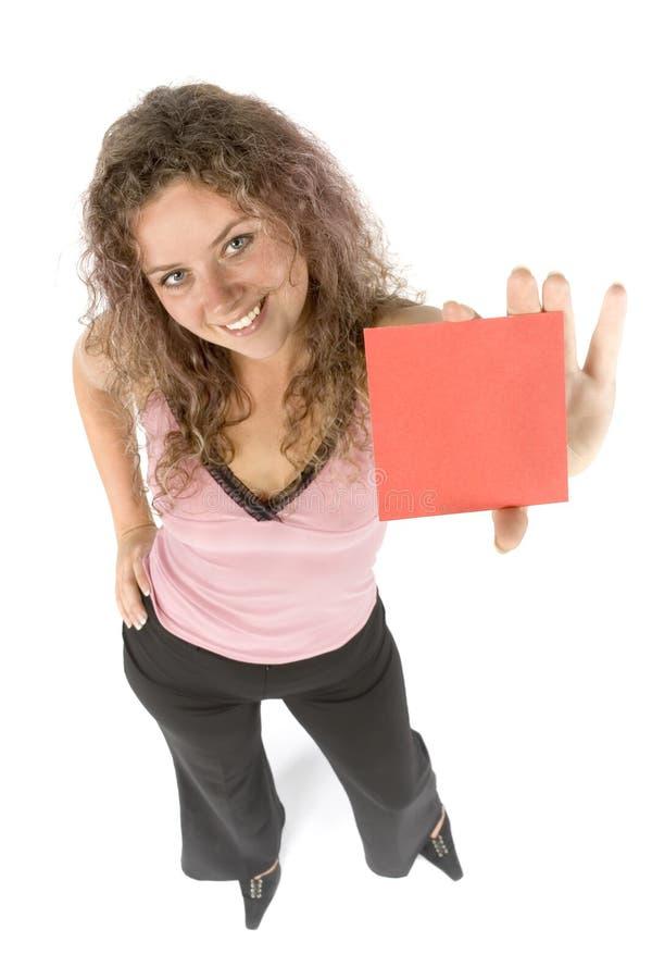 Donna con la scheda di messaggio fotografia stock libera da diritti
