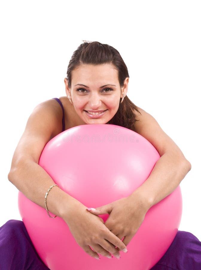 Donna con la sfera di forma fisica immagini stock libere da diritti