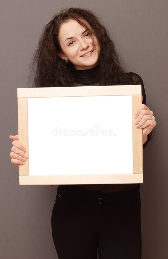 Donna con la struttura fotografia stock