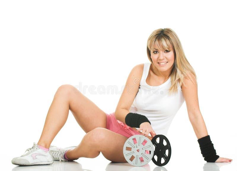 Donna con le bobine di pellicola fotografia stock libera da diritti