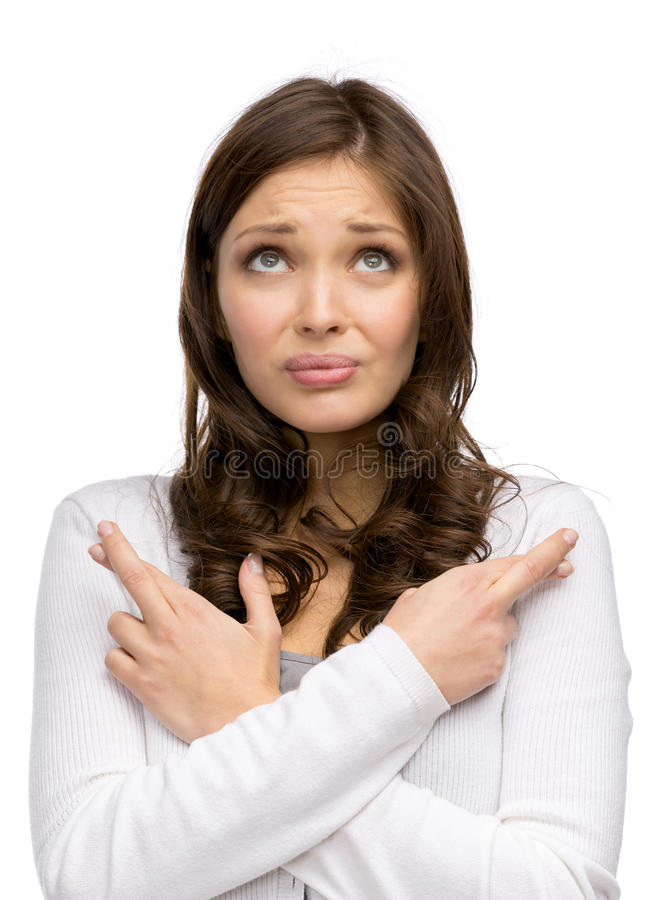 Donna con le dita e le mani attraversate immagine stock