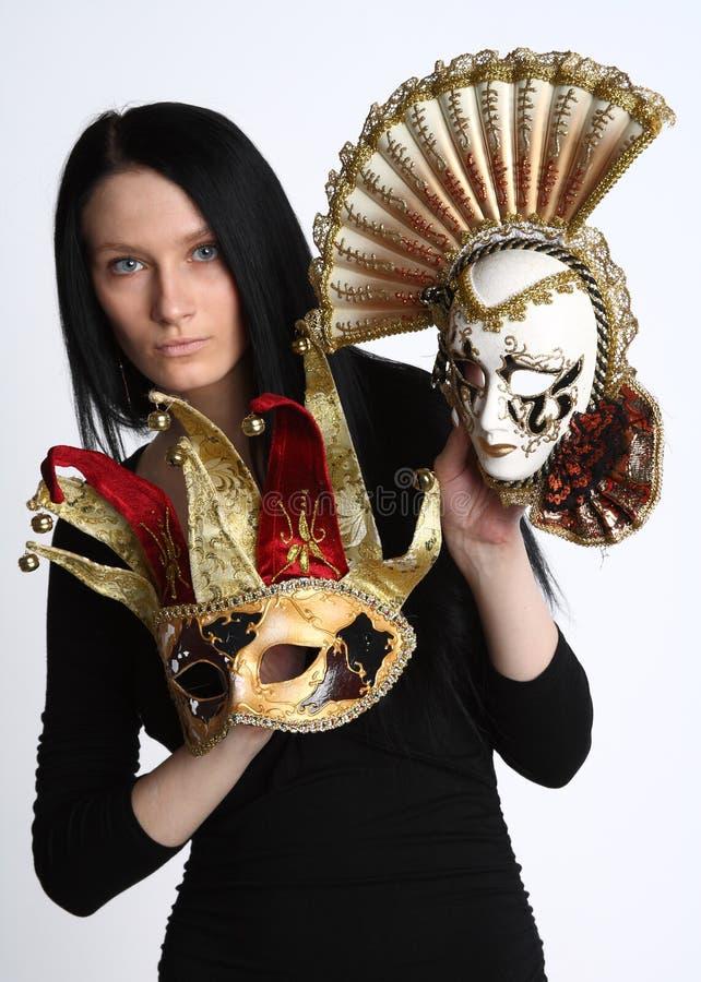 Donna con le mascherine fotografia stock