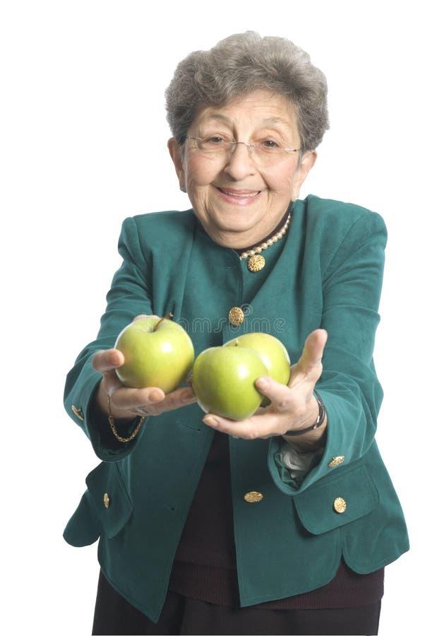 Donna con le mele fotografia stock libera da diritti