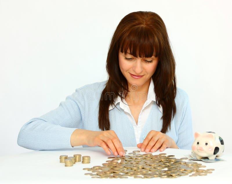 Donna con le monete fotografia stock libera da diritti