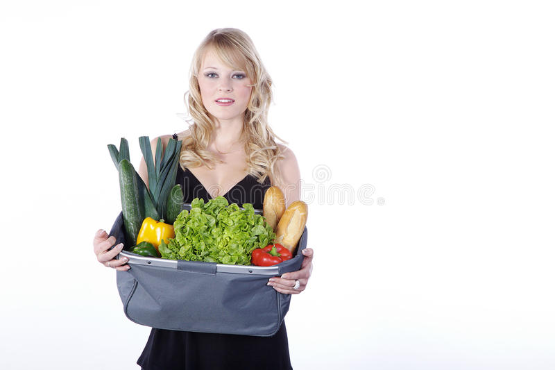 Donna con le verdure e la frutta fotografia stock