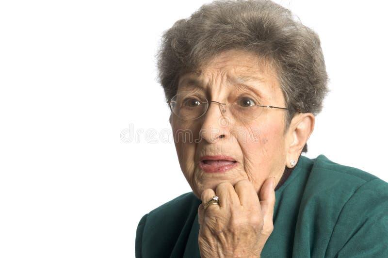 Donna con lo sguardo scosso immagini stock