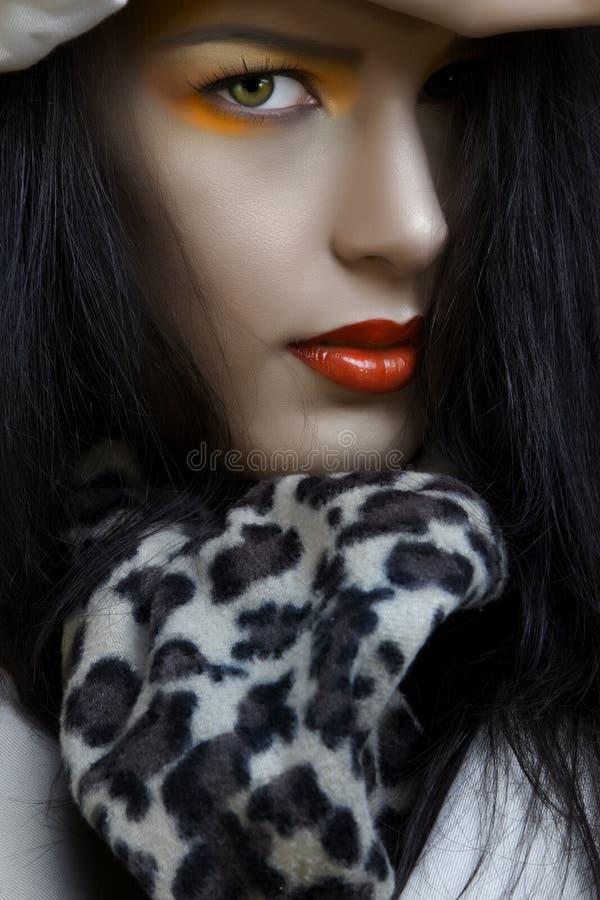 Donna con trucco arancione fotografia stock libera da diritti