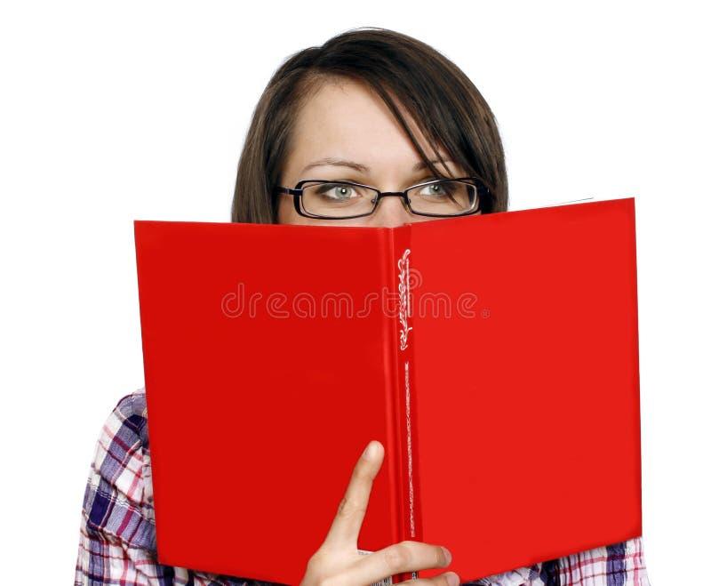 Donna con un libro fotografia stock