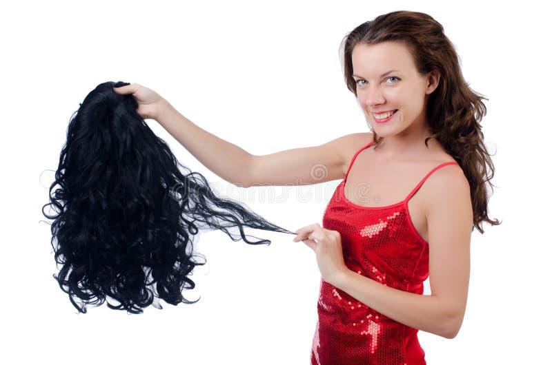 Donna con una selezione della parrucca fotografia stock