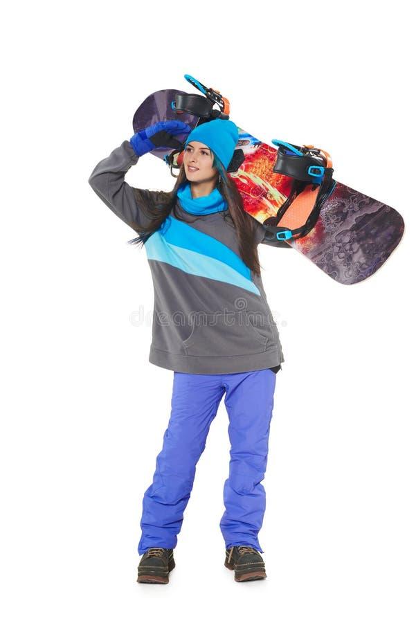 Donna con uno snowboard immagine stock libera da diritti