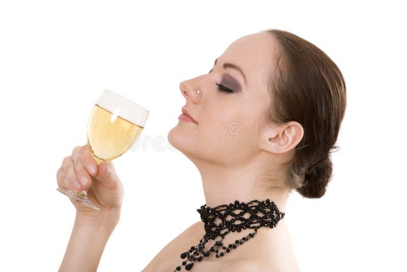 Donna con vetro di vino fotografia stock libera da diritti