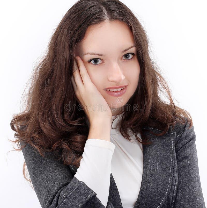 Donna confusa di affari del ritratto giovane Isolato su un bianco fotografia stock