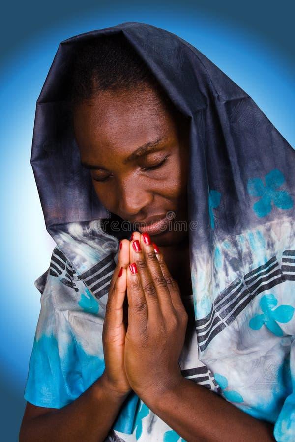 Donna cristiana africana immagine stock