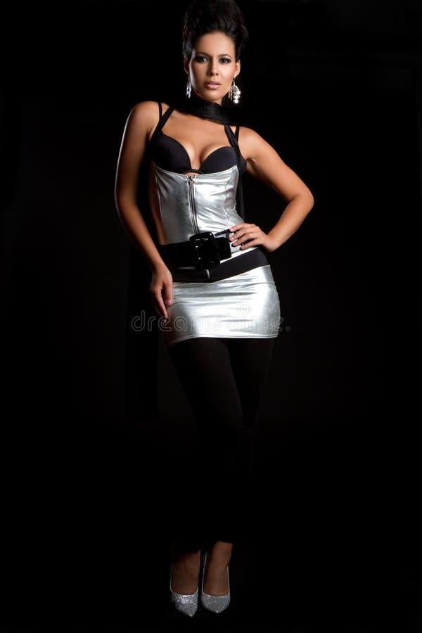Donna d'argento del vestito fotografia stock
