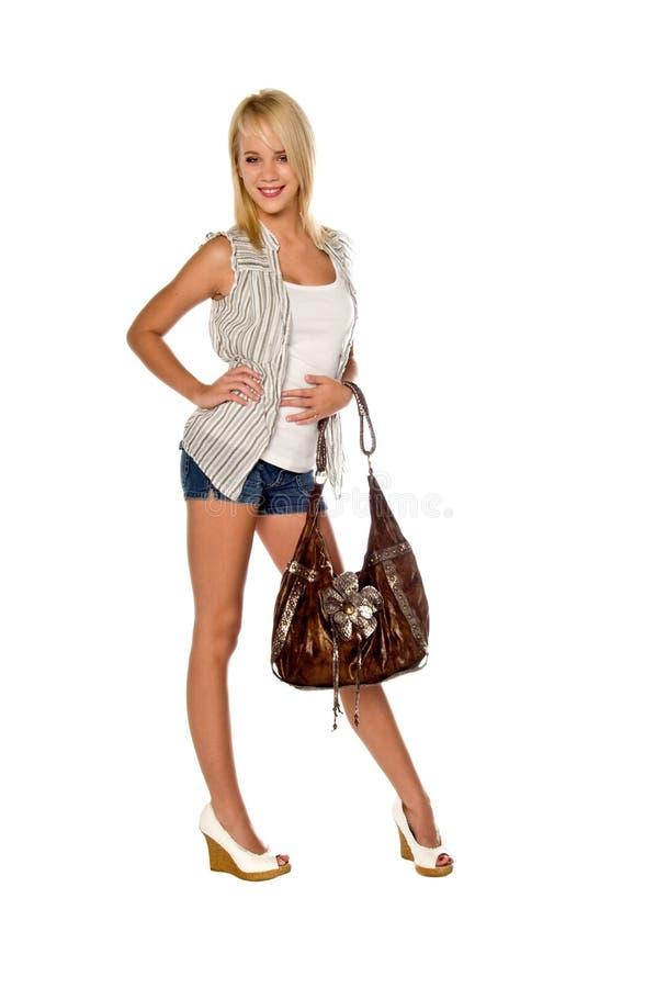 Donna d'avanguardia con la borsa fotografie stock libere da diritti
