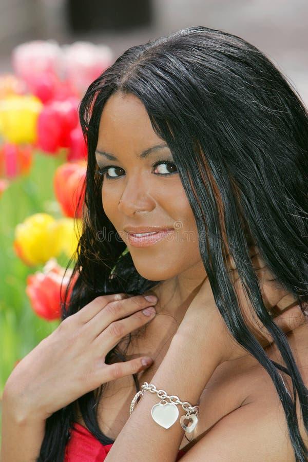 Donna dai fiori immagini stock libere da diritti