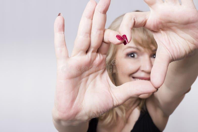 Donna del cuore fotografia stock libera da diritti