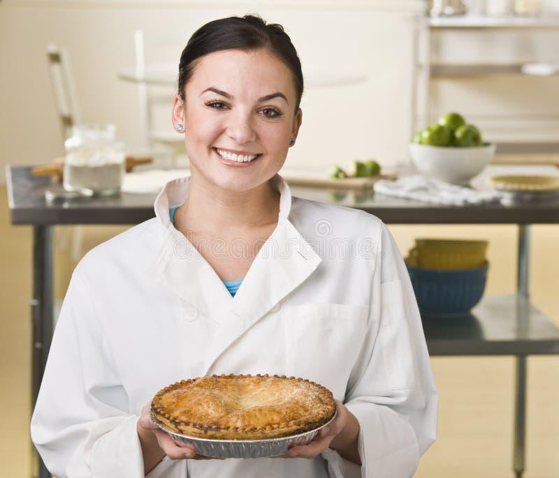 donna del grafico a torta della holding immagini stock
