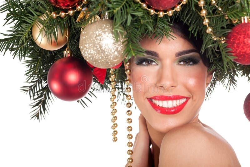 Donna del modello di moda di Natale L'acconciatura del nuovo anno di natale e fa fotografie stock libere da diritti