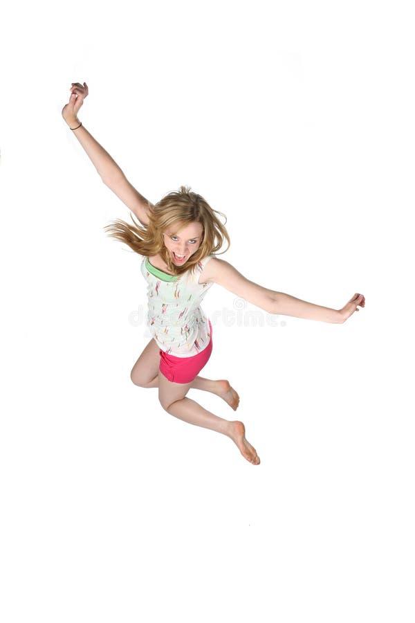 Donna del oung di Attractivey che salta per la gioia fotografia stock