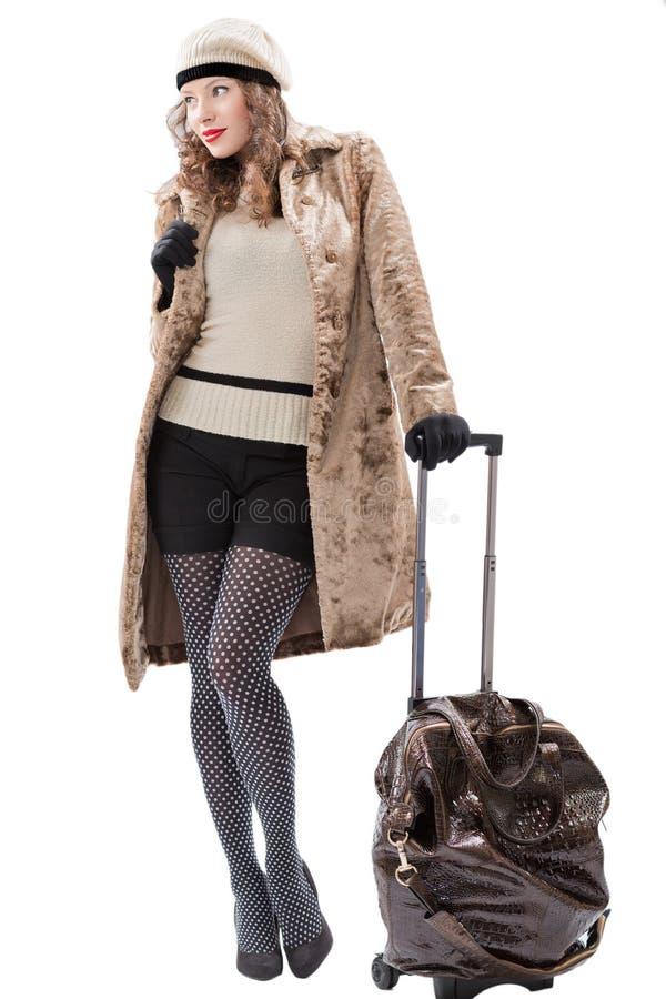 Donna del viaggiatore con una borsa fotografia stock libera da diritti