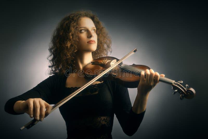 Donna del violinista con il violino fotografie stock