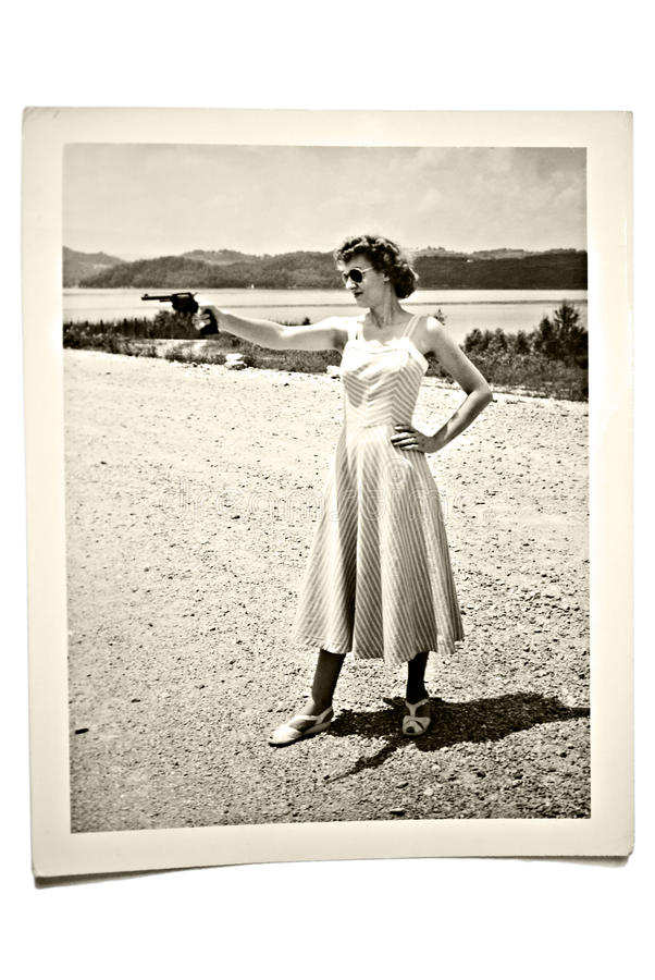 donna dell'annata della foto della pistola immagini stock libere da diritti