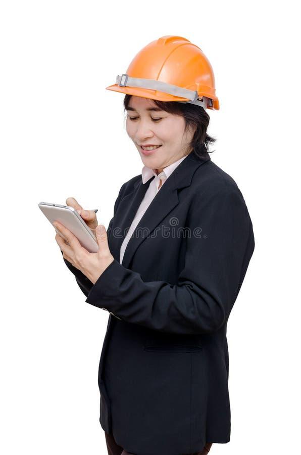 Donna dell'ingegnere con il casco sopra bianco fotografia stock