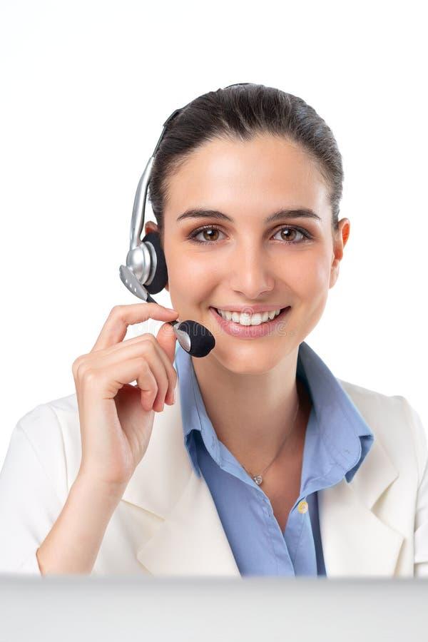 Donna della cuffia avricolare di vendita per televisione dalla call center immagini stock