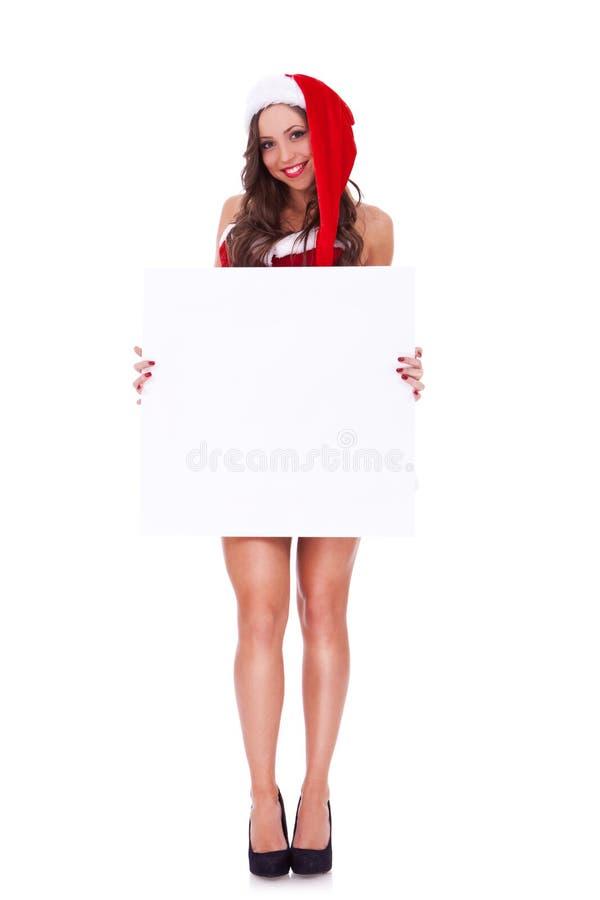 Donna della Santa che presenta una scheda in bianco fotografia stock libera da diritti