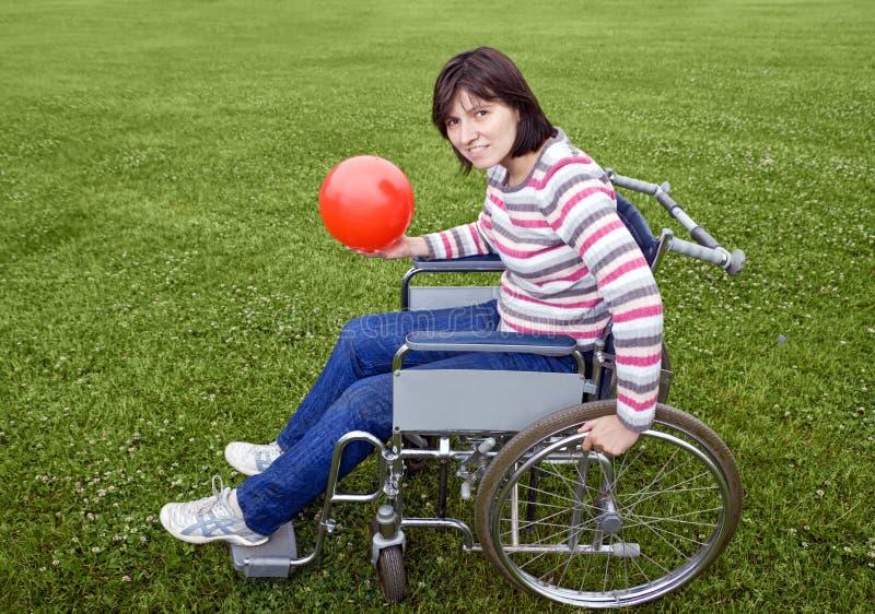 donna della sedia a rotelle fotografia stock