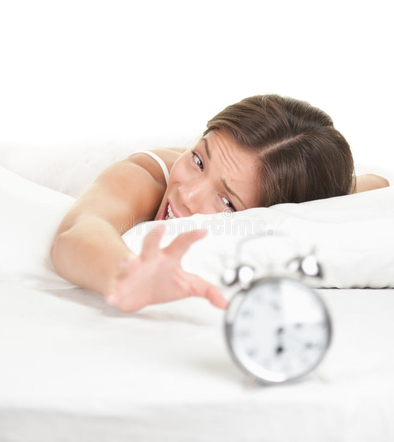 Donna della sveglia che sveglia in ritardo nella base fotografia stock libera da diritti