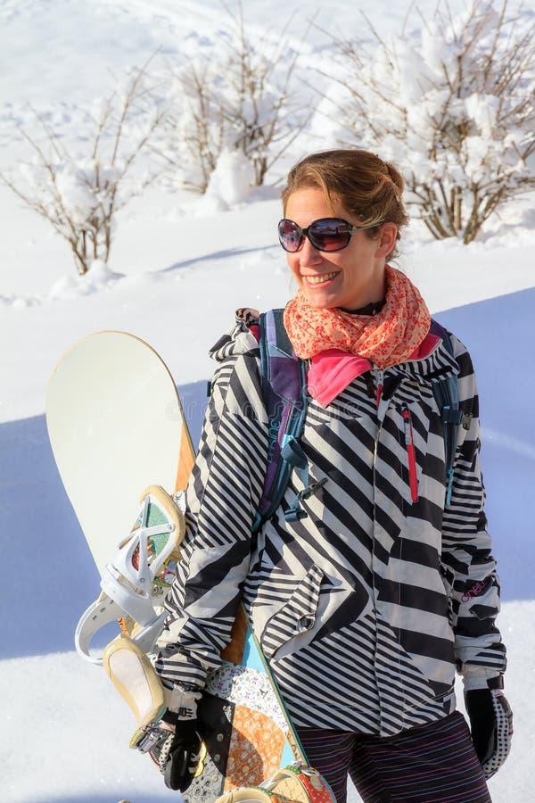 Donna dello snowboard fotografia stock
