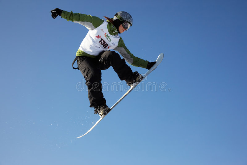 Donna dello snowboard della mosca immagine stock