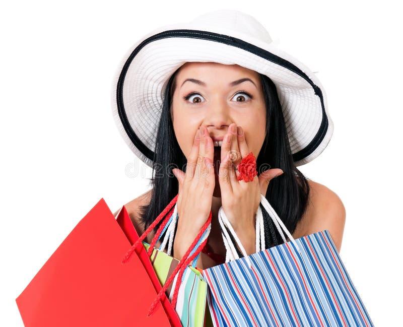 Donna di acquisto su bianco fotografia stock libera da diritti