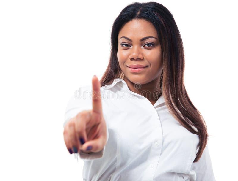 Donna di affari africana che mostra un dito fotografia stock libera da diritti