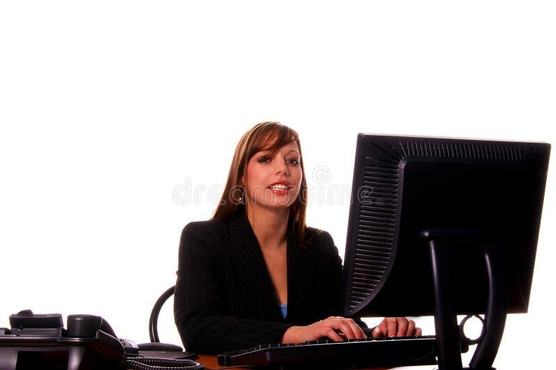 Donna di affari al suo scrittorio immagine stock