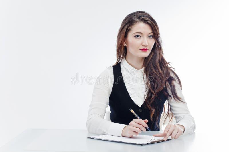 Donna di affari allo scrittorio fotografia stock libera da diritti