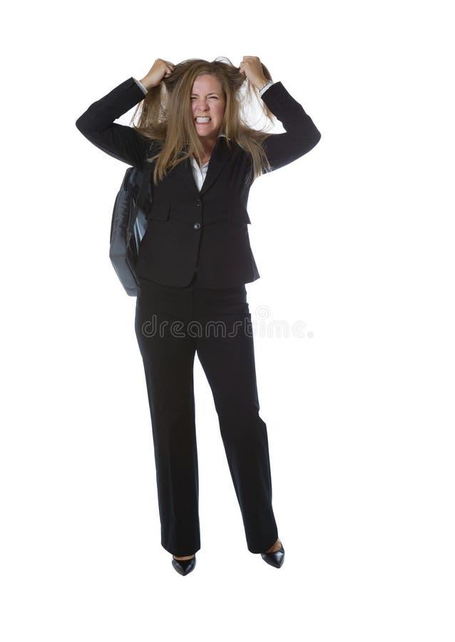 Donna di affari arrabbiata che tira i suoi capelli fotografie stock libere da diritti