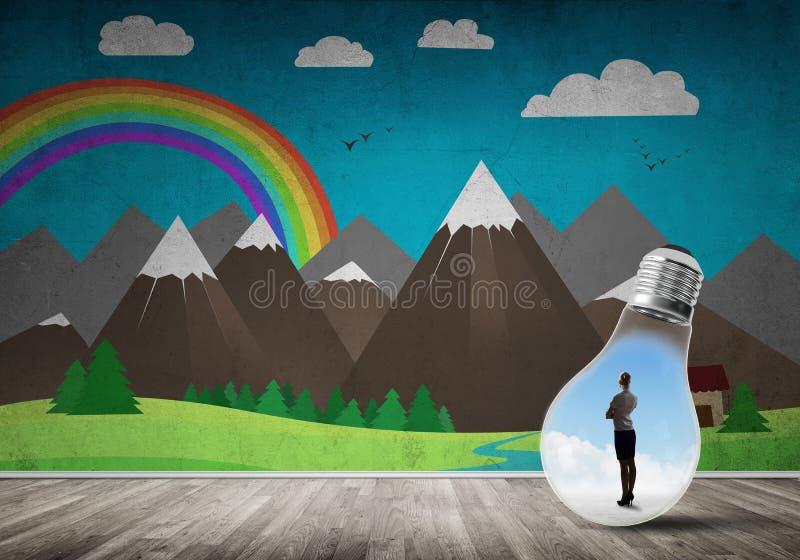 Donna di affari bloccata in lampadina immagini stock