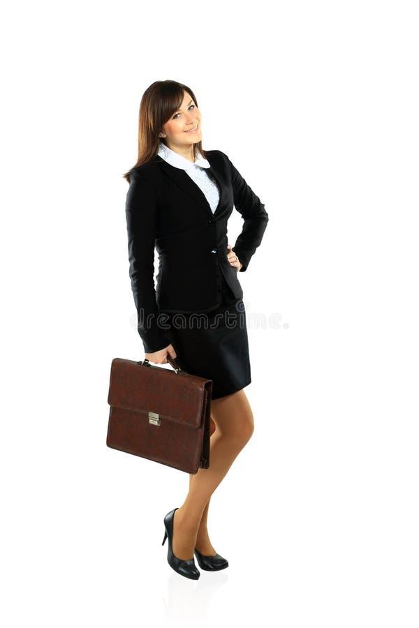 Donna di affari che cammina con una cartella immagini stock libere da diritti