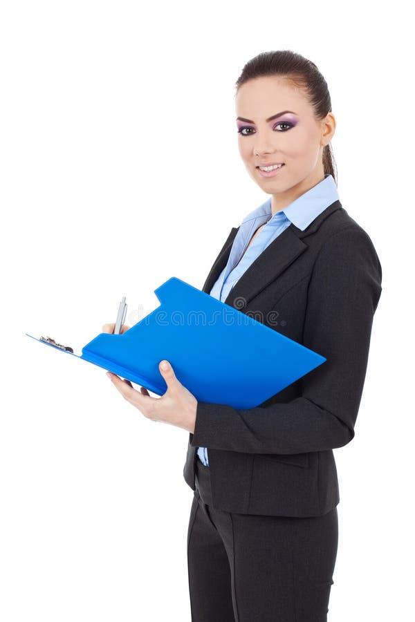 Donna di affari che cattura le note fotografia stock