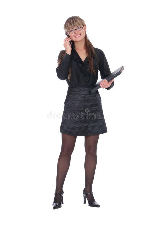 Donna di affari che chiama dal telefono fotografia stock