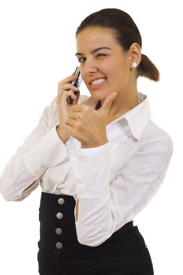 Donna di affari che comunica dal telefono delle cellule immagine stock libera da diritti