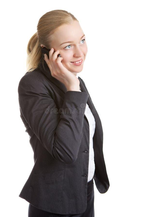 Donna di affari che comunica sul telefono delle cellule fotografie stock