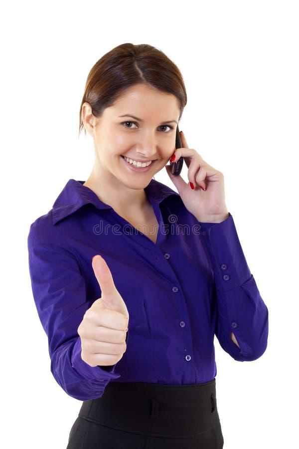 Donna di affari che comunica sulla cella immagine stock libera da diritti