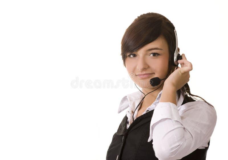 Donna di affari che comunica sulla cuffia avricolare immagini stock libere da diritti